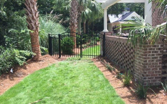 Before and After – Arched Aluminum Gate