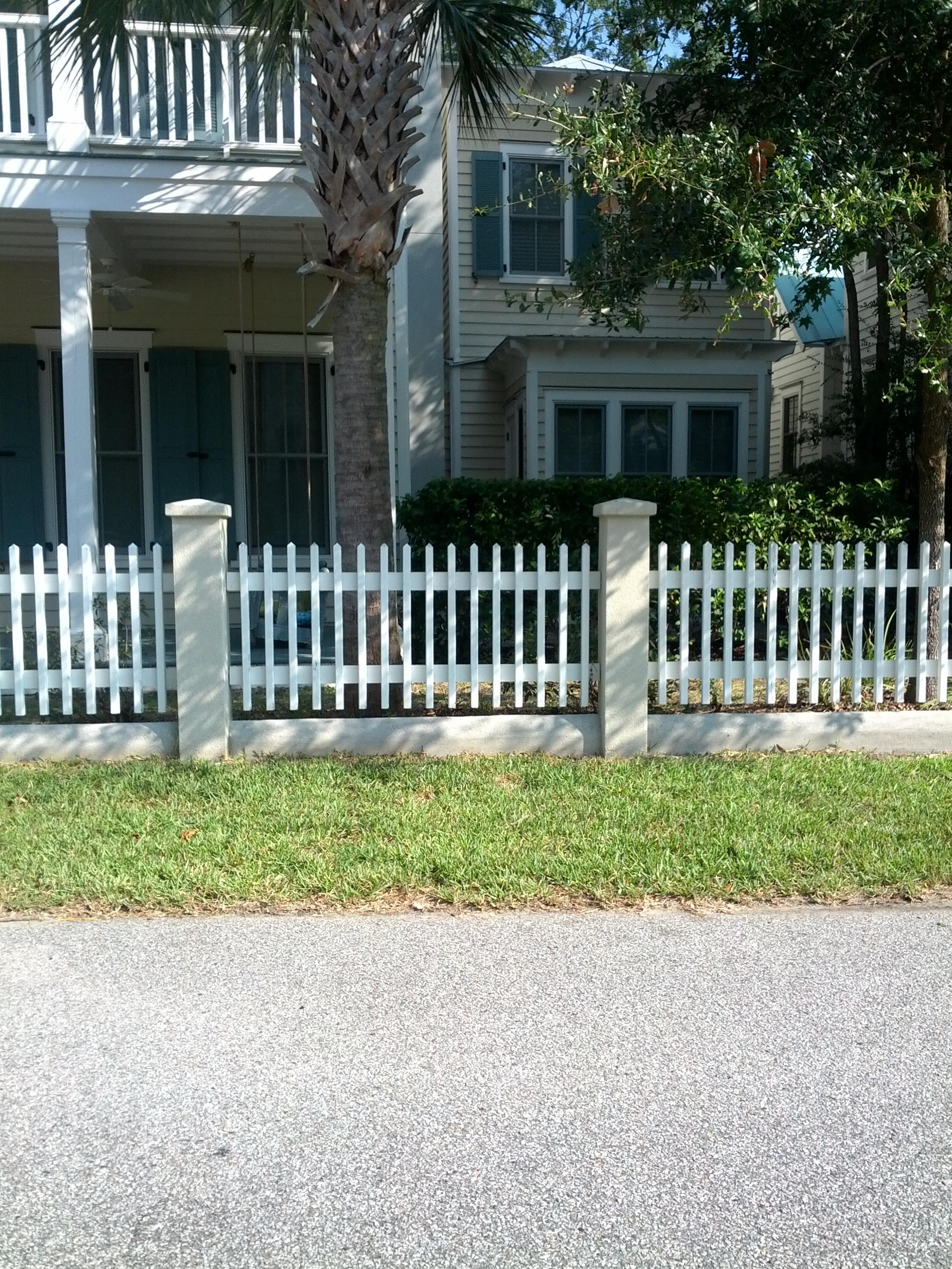 4 feet picket fence between stucco